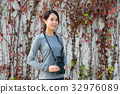 Woman with binoculars 32976089