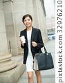 Businesswoman walking at street 32976210