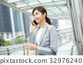 Business woman on mobile phone 32976240