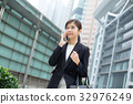 Asian business woman chat on mobile phone 32976249