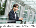 Businesswoman use of mobile phone 32976292