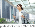 Asian business woman on the cell phone 32976328