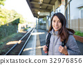 Woman waiting for train 32976856