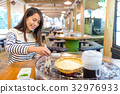Woman having famous japanese cold noodles in restaurant 32976933