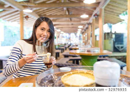 Woman having famous japanese somen in restaurant 32976935