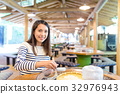 Young Woman having noodles in japanese restaurant 32976943