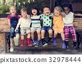 Group of kindergarten kids friends arm around sitting and smilin 32978444