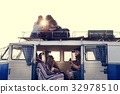 People Sitting on The Roof and inside of The Van on Road Trip Br 32978510