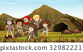 Kids in safari costume camping out by the cave 32982221