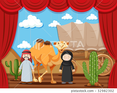 Stage play with two people playing arabs in desert 32982302