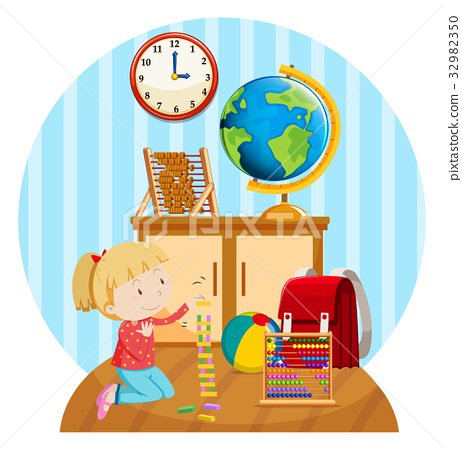 Little girl plays blocks in room 32982350