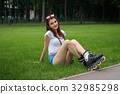 Cutie young girl with roller on her legs resting 32985298