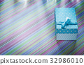 Gift box on striped tablecloth horizontal image 32986010