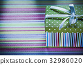 Decorated gift box on striped fabric holidays 32986020