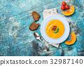 Pumpkin and carrot soup 32987140