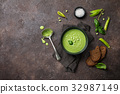 Green pea soup in bowl 32987149