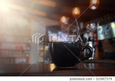 abstract blur hot black coffee  with wooden 32987574