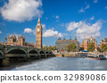 Big Ben with boat in London, England, UK 32989086