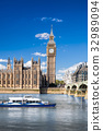 Big Ben  with boat in London, England, UK 32989094