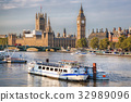 Big Ben  with boat in London, England, UK 32989096