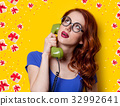 girl in blue dress with dial phone 32992641