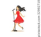 Young beautiful brunette girl in red dress singing 32992710