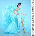 Fashion model in blue blowing chiffon dress 32993963