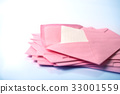Stacking of pink envelopes and mail letter paper  33001559