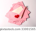 Stacking of pink envelopes and mail letter paper  33001565
