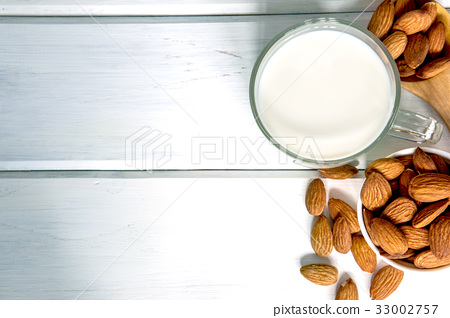 healthy almond milk in the drinking glass  33002757