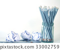 silver pencil in glass jar with the crumpled paper 33002759