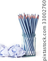 silver pencil in glass jar with the crumpled paper 33002760