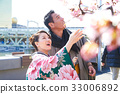 happy couple is enjoying cherry blossoms in japan 33006892
