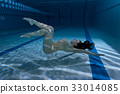 Swimmer in the pool under the water. 33014085