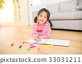 Little child girl draws with colored pencils 33031211