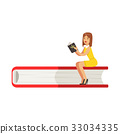Micro young woman sitting on a giant book, girl 33034335