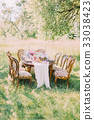 Beautifully decorated wedding table with fruit 33038423