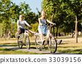 grandmother, riding, bicycle 33039156