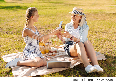 Positive cute teenager girl resting in the park 33039286