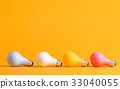 Colored light bulbs on a yellow background 33040055