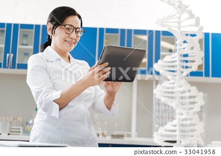 Delighted smart woman doing her job 33041958