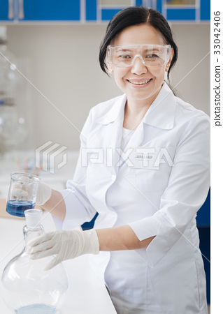 Happy nice woman working in the chemical lab 33042406