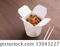Asian food in delivery box on wooden table 33043227