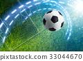 Soccer ball on green soccer stadium 33044670