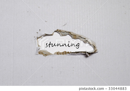 The word stunning appearing behind torn paper 33044883