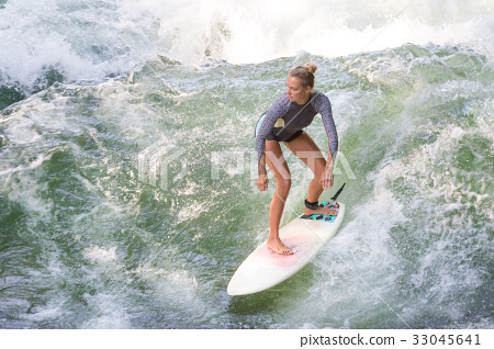 Atractive sporty girl surfing on famous artificial 33045641