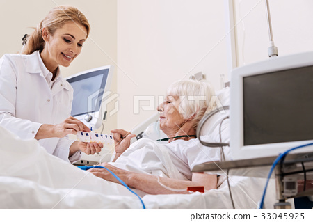 Clever wonderful doctor giving her patient 33045925