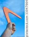 Boomerang in front of a blue sky 33047664
