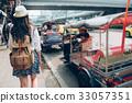 Thai traditional taxi tuk tuk car with woman. 33057351