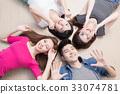 young people lying on floor 33074781